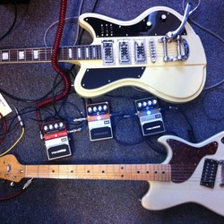 Three%20hardwire%20pedals%20with%20two%20guitars medium